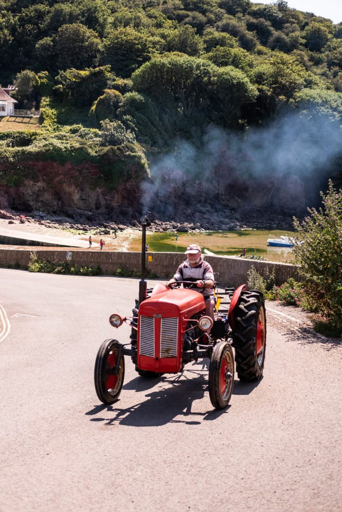 Tractor passing Hope Cove House